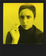 Lucia, frowned (ale2000) Tags: impossible analog analogue i1 i1camera 600 yellowandblack yb roidweek polaroidweek roidweekspring2017 instant instantphotography yellow giallo nero black portrait portraiture ritratto frowned frowning accigliata cigarette sigaretta smoking fumatrice fumo mano hand viso face visage