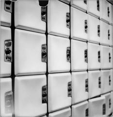 Protect Your Balls ([jonrev]) Tags: polaroid sx70 sonar autofocus model 2 lockers locker doors bowling center alley brunswick 2000 combination locks impossible project black white
