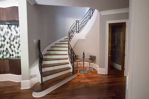 Curved staircase into the basement by Andronx stairs