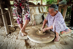 Senior woman making pottery ([ 117 Imagery ]) Tags: family woman tourism senior river shopping asia southeastasia handmade traditional culture craft visit tourist vietnam hoian pot souvenir clay pottery production tradition handcraft craftmanship touristdestination traveldestination quangnam quangnamdanang