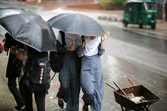 A Passing of sorts.... (N A Y E E M) Tags: street girls boys students rain umbrella monsoon passing bangladesh chittagong ashkardighirpar