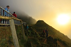 Here Comes the Sun (Pedestrian Photographer) Tags: morning bali sun june fog sunrise indonesia dawn volcano early am asia mt cloudy watching hike tourists mount southeast equator batur morn 2013 dsc6932 dsc6932jpg