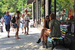 heart-to-heart (omoo) Tags: newyorkcity girls window glass reflections cigarette streetscene sidewalk americanapparel girlfriends prettygirls greenwichvillage sunnyday hearttoheart smokinggirl girlstalking sidewalkbench dscn5098 girlsmokingcigarette bleeckernearminettalane candycoloredbench