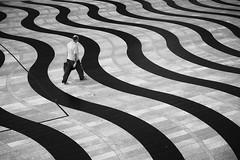 Droit dans le vague (Bernard Chevalier) Tags: street abstract silhouette solitude peinture v passage vague géométrie ville homme vide passant décor urbanisme dehors abstrait graphisme courbes piéton géométrique ague