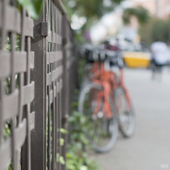 A year of sundays 5/52 (idni . idniama) Tags: barcelona orange bicycle fence 50mm nikon bokeh taxi bicicleta photowalk gettyimages 2013 ayearofsundays gettyimagesiberiaq3 camardas unaodedomingos