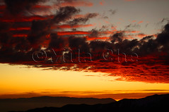 Dramatic fiery sunset over the mountains (Mila Che) Tags: cloud orange sky sunset dusk sun mystical red twilight dawn sunlight yellow beautiful color light fiery background beauty heaven dramatic outdoor view evening landscape meteorology majestic heat bright colorful scenic horizon stratosphere gold dark mountains glow atmosphere sundown afterglow