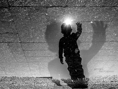 » ...age? (Jeff Krol) Tags: age boy reflection flipped upsidedown sun wave layers silhouette shadow contrast amsterdam candid street streetphotography nederland netherlands dutch straatfotografie straat blackandwhite bw mono monochrome noir jeffkrol 2017 jeff krol 20170325dsc00376