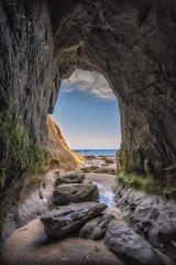 cueva (Mauro Esains) Tags: cueva cielo gruta piedras mar playa comodoro rivadavia sur rada tilly chubut olas arena frio humedad nubes marea baja musgo verde sol verano restinga punta del marqués