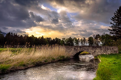 Bridge (marco soraperra) Tags: landscape water river flow bridge stone grass field mountains clouds sky sun sunset sunlight light shadow tree trees nikon nikkor nature