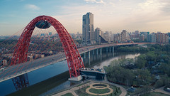 Picturesque bridge. Moscow. Aerial drone shot. (oleg.korchagin) Tags: aerial arched architecture beautiful blue bor bridge cable cablestayed city cloud construction drone fragment horseshoe krylatskoe landmark metal modern moscow picturesque red restaurant river russia scenic serebryany sky steel structure trafic urban water white zhivopisny