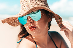 Close up portrait of woman on the beach wearing hat and sunglasses (Kléber Cordeiro) Tags: adult attractive beach beautiful beauty blue caucasian closeup face fashion female girl glamour glasses hair happy hat holiday leisure lifestyle model one outdoors portrait relax relaxation sea sky summer sun sunbathe sunglasses sunlight sunny tan travel tropical twenties vacation wearing white woman young