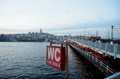 Galata bridge in new light.. (roomman) Tags: bridge sea water sign turkey river istanbul wc straits strait bosphorus galata 2013 bosfors marmama