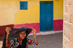 Smile, Badami (Marji Lang Photography) Tags: life travel portrait people india house home colors girl smile smiling yellow composition happy photography kid colorful child good peekaboo indian streetphotography documentary streetportrait happiness shy littlegirl lovely karnataka bluedoor lovelygirl inde badami spontaneous happypeople lifeisbeautiful happygirl positivity travelphotography behappy dontworry indiangirl shysmile dupatta colorfulhouse 2013 bepositive sparklingeyes giveasmile marjilang