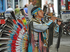 Playing the Pan Pipes (littlestschnauzer) Tags: street york city uk autumn music streets colour leather shopping square costume nikon october artist expression indian yorkshire centre main pipes feathers atmosphere historic musical elements shops pan colourful tradition busking facial zone entertaining tassels concentrating in headress 2013 d5000
