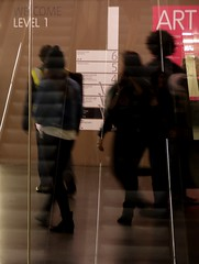 Someone behind someone with someone next to someone (Grooover) Tags: people reflection london glass modern gallery tate escalator grooover