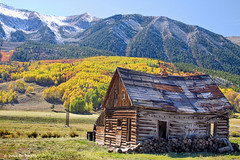 Rustic Rural Colorado Cabin Autumn Landscape (Striking Photography by Bo Insogna) Tags: travel blue autumn trees winter red vacation orange house mountain mountains tree green nature beautiful beauty rural forest rockies gold cabin october colorado colorful seasons background rustic rocky peak bluesky september autumncolors fallfoliage cottonwood aspens rockymountains wilderness crestedbutte gunnisoncounty coloradonature autumnlandscape coloradolandscapes coloradoautumn jamesboinsogna coloradonaturelandscape vision:mountain=0566