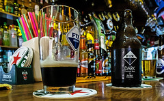 Lovely a Fix Dark - Dark Hellenic Beer (Bar in Rhodes Town - near the bus station) (Fuji XM1 & 16-50mm zoom) (markdbaynham) Tags: beer fix dark greek town bottle high fuji drink hellas x iso greece grecia trans pefkos rodos rhodes fujinon csc hellenic pefki xm1 1650mm digitaldepotcouk