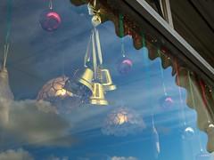 Shop Window, Market Jew Street, Penzance (chrisotruro) Tags: winter sky glass clouds bells reflections lights cornwall december christmasdecorations tinsel shopwindow baubles penzance marketjewstreet panaleicasummilux