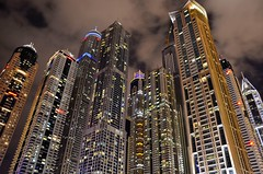 Dubai at Night (slavkit) Tags: street new city blue light sky urban panorama color reflection building tower window water glass skyline architecture modern night skyscraper buildings corporate design town office high construction downtown dubai pattern cityscape exterior estate view apartment background steel united uae perspective property landmark scene structure business emirates arab tall financial futuristic mygearandme mygearandmepremium mygearandmebronze vision:mountain=0552 vision:outdoor=095 vision:sky=0625 vision:street=051