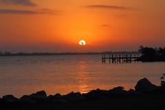 SUN OVER PIER (R. D. SMITH) Tags: sunrise river dawn indianriver florida sky canoneos7d melbourneflorida water clouds orange morning brevaedcountyforida