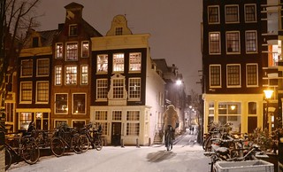 Like biking in a wintry painting of Amsterdam