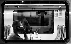 2017_89 (Chilanga Cement) Tags: fuji fujix100f x100t xseries x100f bw blackandwhite mono train commuter station phone window bottle seat perspective man guy travel traveller