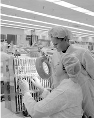Atlas Collection Image (San Diego Air & Space Museum Archives) Tags: florescentlight labcoat magnifyingglass electronicsassembly electronic factory weddingband assembly assember pointtopointwiring workbench 1967 cardcage