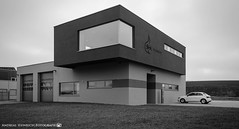 The Fire Station of Dahenfeld. (andreasheinrich) Tags: architecture firestation afternoon february blackandwhite blackandwhitephotos overcast cold germany badenwürttemberg neckarsulm dahenfeld deutschland architektur feuerwache nachmittag februar schwarzweis bewölkt kalt nikond7000