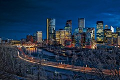 Calgary April Blue Hour (John Andersen (JPAndersen images)) Tags: bowriver calgary cloudy longexposure night office skyline towers yyc
