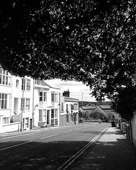 Terminus Road, Brighton (alisonpettyphotography) Tags: brighton city street photography documentary reportage light tree flight hove sussex sky clouds text black white blackandwhite