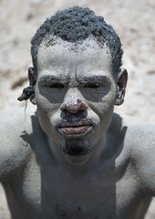 Borana tribe man covered with salt after diving in the volcano crater to collect salt, Oromia, El Sod, Ethiopia (Eric Lafforgue) Tags: adult africa african blackpeople borana colourpicture country crater danger dangerous day developingcountry elsod ethiopia ethiopia0317068 ethiopian ethnic extinctvolcano hardwork head headshot hornofafrica lake lookingatcamera men naturalphenomenon onemanonly oneperson oromia oromo oromya outdoors poverty protection realpeople resources saline salt saltlake sod toxic tribe vertical volcanic volcano water worker