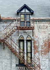 rusty fire escape (sharon'soutlook) Tags: fireescape rust rustty building windows whitebricksstairsstained glasschurchoutdoorshamilton oh explore peelingpaint