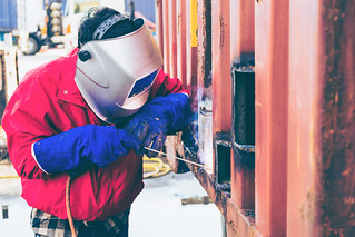 Welder worker repair the damage container wall