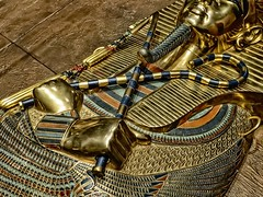 Closeup of the crook and flail on King Tutankhamun's first inner coffin New Kingdom 18th Dynasty Egypt 1332-1323 BCE (mharrsch) Tags: crook flail gravegoods gold pharaoh king ruler coffin tutankhamun burial tomb funerary 18thdynasty newkingdom egypt 14thcenturybce ancient discoveryofkingtut exhibit newyork mharrsch premierexhibits