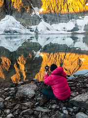 Edwina lining up a shot, Floe Lake, Kootenay National Park, British Columbia (www.clineriverphotography.com) Tags: reflections floelake landscape kootenaynationalpark britishcolumbia goldenhour water vertical light canada location 2013 lake aspect
