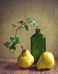 Pear Still Life (Through Serena's Lens) Tags: pear fruit food texture yellow bottle green glass ivy plant vine tabletop indoor light shadow stilllife