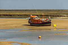 No Lifesaving Today (Kev Gregory (General)) Tags: retired restored rnli boat 3734 horace clarkson sits high dry sand bank wellsnextthesea norfolk stands grounded during low tide wells next the sea coast coastline estuary north sunny sun water kev gregory canon 7d england royal nation lifeboat institution rnlb a sail east fleet salt marsh marshes