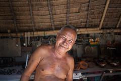 Mr Botol. (Sitoo) Tags: gili giliislands indonesia lombok asian craftsman indonesian man peopleoftheworld portrait shop smile travel meno gilimeno
