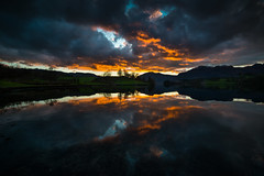 The sun sets in the west (Tore Thiis Fjeld) Tags: norway etne osvåg night fjord sea sunset colors sky clouds nature panorama silhouettes reflection afterburn outdoors silence mirror nikon d800 samyang 14mm