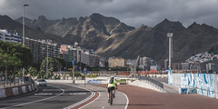 Santa Cruz de Tenerife (Paul Hemmen) Tags: santa cruz tenerife canarische eilanden canary islands mountains light sunset bike biker urban street boulevard harbor sea santacruz