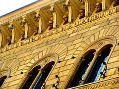 Heads peering out of the banking building of Siena (MJ_New York) Tags: summer italy money history ancient italia power statues bank center creepy tuscany heads siena richness toscana homage trade greatness commodity wealth 2012