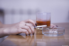 hand holding a cigarette (Amickman) Tags: glass girl female table person women hand habit drink cigarette smoke communication negative health alcohol getty whisky conversation meditation language ashtray liquid bodypart gettimages