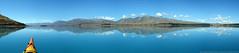 Kayaking in Paradise (Magryciak) Tags: blue sky panorama mountain lake colour reflection water landscape mirror kayak paddle southisland laketekapo 2013