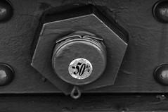 -50% (Joseph Austin) Tags: newyorkcity bridge bw usa newyork black monochrome graffiti blackwhite sticker key paint sale tag off brooklynbridge bolt graffito nut graff 50 50off cotter nutbolt blackpaint cotterkey cotterpin