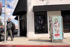 Free Humanity (See El Photo) Tags: auto california ca street urban 15fav favorite cloud streetart man color colour building guy window car saint sign cali clouds digital standing canon bag poster outside religious outdoors eos rebel stand store colorful catholic colore post wheatpaste paste streetsign mary homeless ad stranger bum dirty dude pole urbanart virgin sidewalk melrose posted pasted signage 100views fav sweatshirt scratch virginmary curb couleur bless itch faved transient trashbag 500d powerbox automoblie 111v1f redcurb 7580 powerboxart t1i