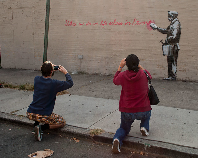 Kneeling Before the Banksy