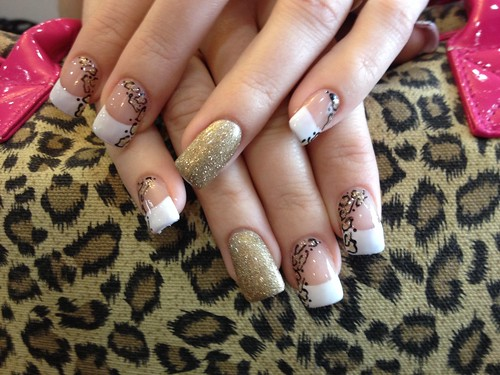 Acrylic Nails With Leopard Print Nail Art A Gold Glitter Ring Finger