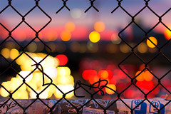 Pink Sunrise Mass Pike Bokeh in Allston, through Chain Link Hole facing Boston (Greg DuBois Photography) Tags: road street city morning pink blue winter red urban usa color cars yellow boston sunrise canon 50mm lights early cool cityscape traffic unitedstates bokeh framed massachusetts stickers newengland overpass sigma chainlink citylights coloredlights rushhour railing masspike pinksunset commuters urbanlandscape allston massachusettsturnpike roadway bostonskyline warmcolors allstonma colorfulsky lowerallston creativephotography canonphotography bokehcircles bokehphotography gregdubois gregduboisphotography {vision}:{sunset}=0712 {vision}:{sky}=0863 {vision}:{outdoor}=088 {vision}:{clouds}=0523