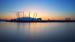 O2 Sunrise II (www.paulshearsphotography.com) Tags: city uk longexposure blue red england orange reflection london water thames sunrise canon river dawn iso100 march construction day cityscape unitedkingdom crane tripod capital greenwich smooth o2 millennium arena le dome tuesday docklands theriverthames riverthames f8 3rd 25mm theo2 northgreenwich 2014 thedome aquablue 25seconds cityvista themillenniumdome 10stop o2arena canonef1635mmf28liiusm theo2arena ef1635mmf28 canoneos5dmarkiii canon5dmarkiii eos5dmarkiii 5dmarkiii prostop triggertrap formatthitech paulshears paulshearsphotography wwwpaulshearsphotographycom irnd formatthitechprostopirnd 10stopirnd triggertrapapp