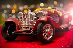 Dust on me (Alessandro Giorgi Art Photography) Tags: dust polvere car model old auto macchina modellino lights luci macro red rosso vecchia style nikon d7000 granello grain alfa romeo small piccola